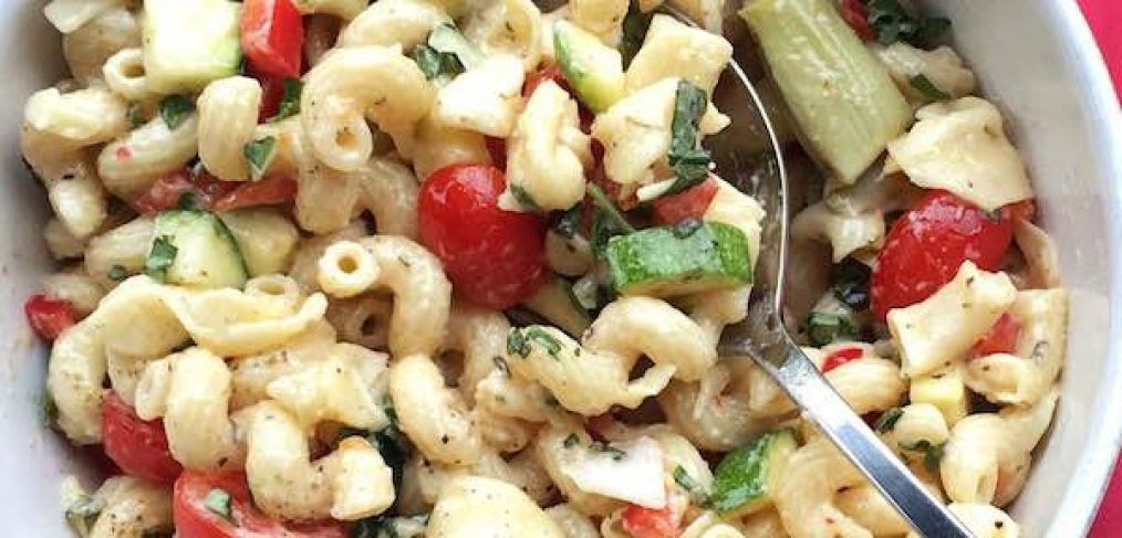 Company Pasta Salad is a delicious, veggie-packed and satisfying side dish that feeds a crowd, can easily be adapted and can be made ahead.