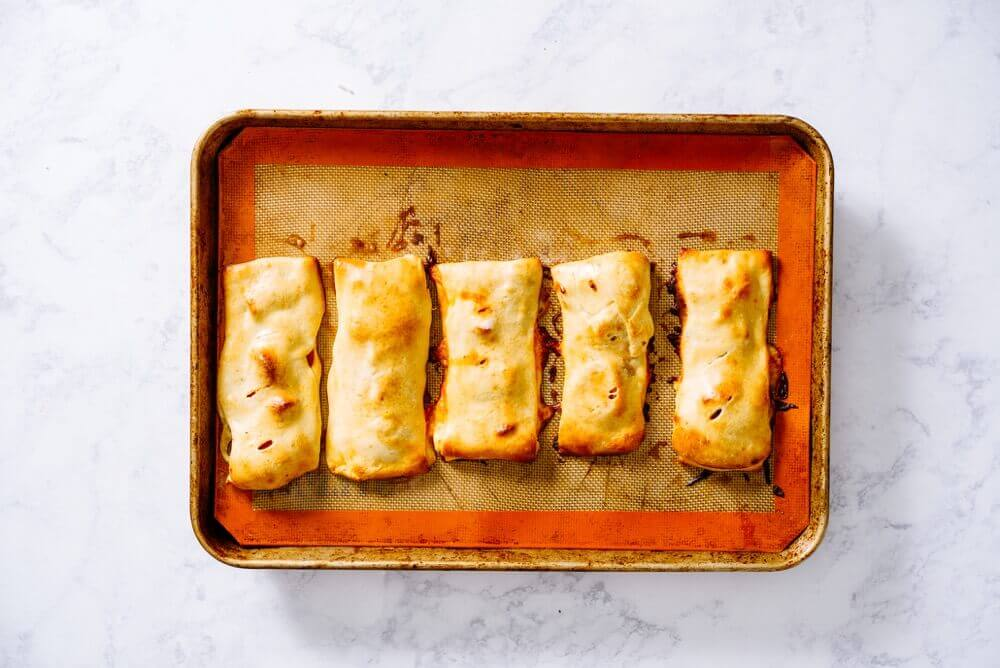 Customize Healthy and Homemade Hot Pockets with fresh ingredients for a portable, freezer-friendly lunch or after-school snack.