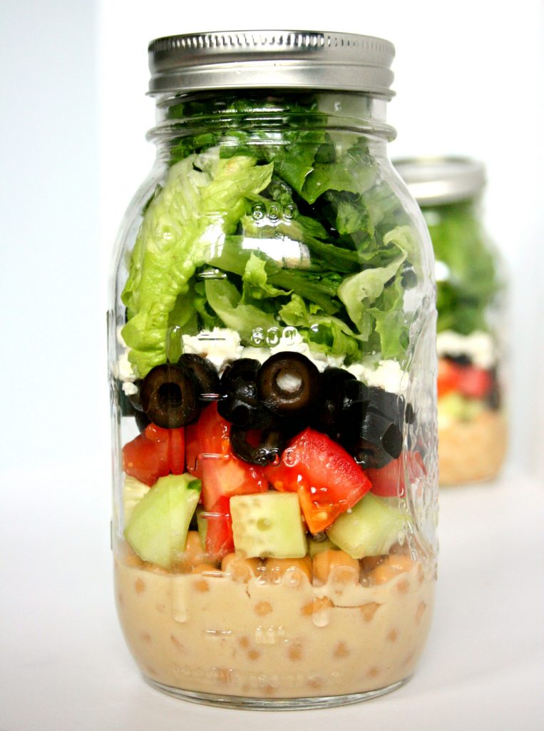 This Mason Jar Greek Salad is packed with tasty and nutritious ingredients that make saying no to fast food a breeze!