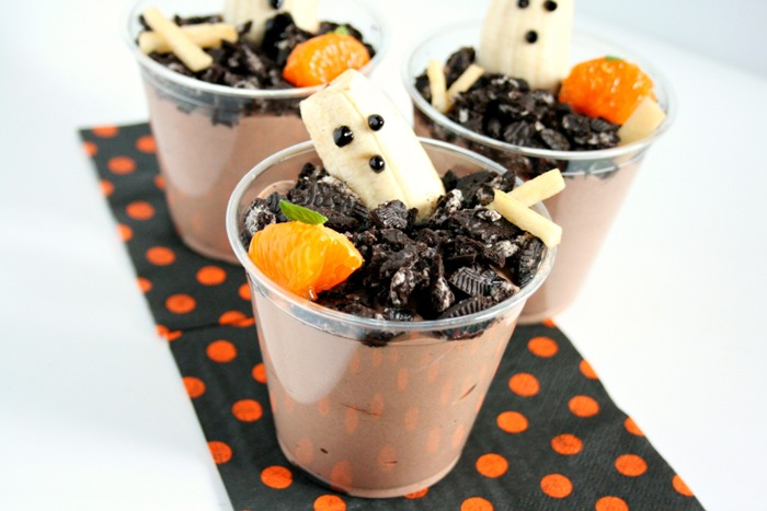 Spooky Graveyard Ghost Cups are a nutritious and fun Halloween snack--just don't tell your little goblins they are eating foods that are good for them!