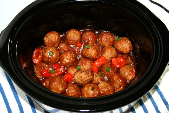 Slow cooker meatballs make an excellent travel-safe holiday potluck dish