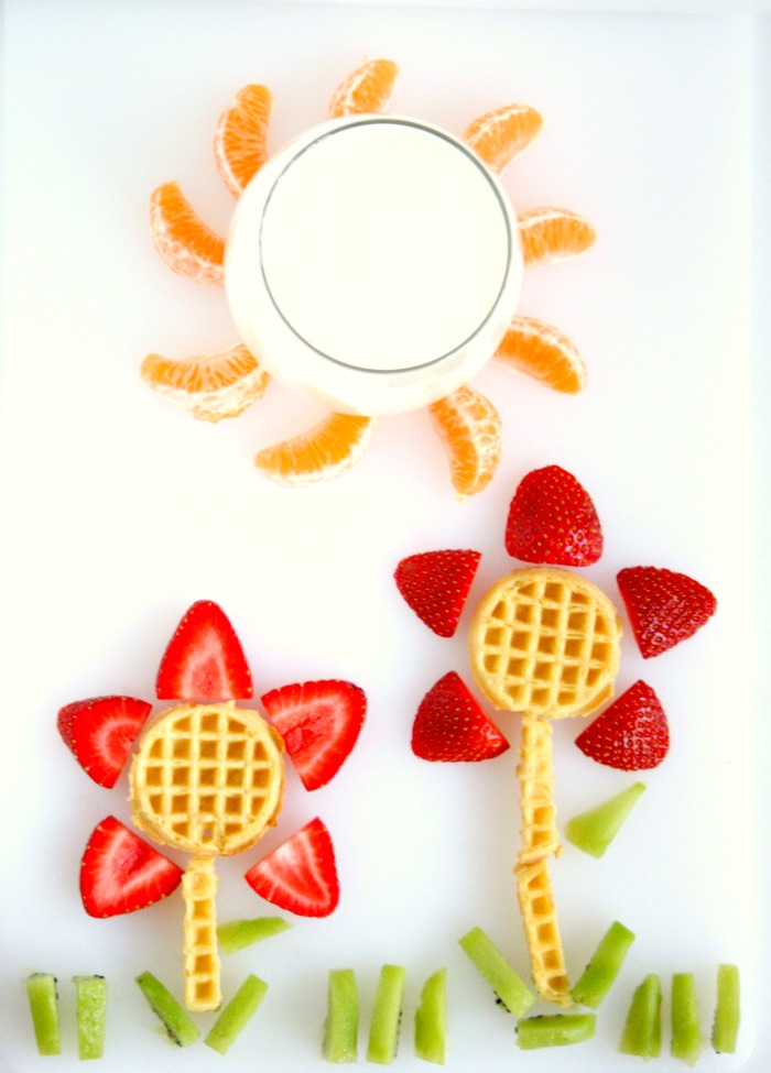 Can we talk cute breakfast ideas for a minute? I love how easy it is to make this fruit and waffle flower garden! Your kids will like making AND eating them!