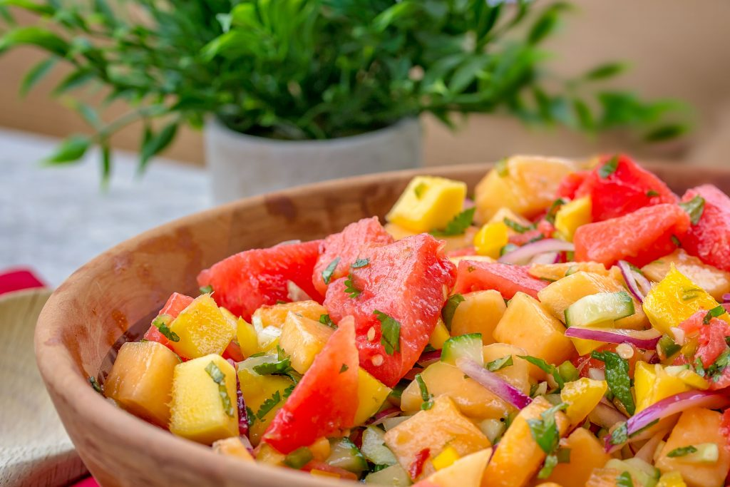 Packed with fresh summer produce like melons, cucumber, bell peppers, citrus, mint and more, Sweet Heat Watermelon Salad boasts a tangy, sweet, and spicy lime vinaigrette. It's simple to make, can easily be doubled to feed a crowd, and pairs well with classic cookout staples like burgers, brats, and more.
