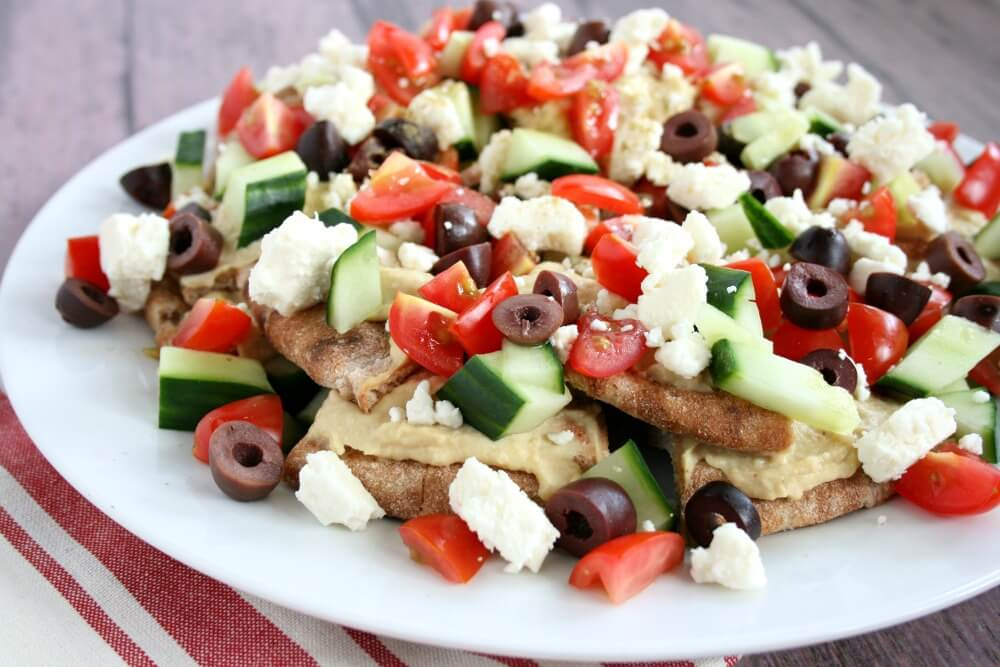 Add a little Mediterranean flare to your mealtime by serving simple, vegetarian No-Cook Greek Nachos. They're delicious for a fresh and fun appetizer, lunch, or dinner.