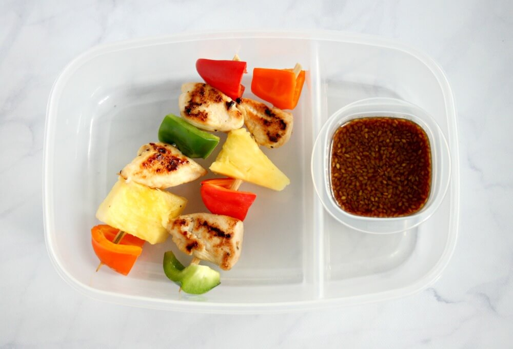 The kids are back in school, but this lunchbox is still on vacation! My pineapple teriyaki chicken skewers are a perfect tropical treat to help ease those back to school blues.