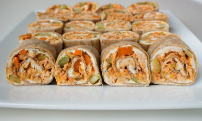 Turn up the heat at your tailgate with spicy Buffalo Chicken Wraps. Enjoy the flavor of traditional buffalo wings (plus celery and carrots, of course) as bite-sized pinwheels.