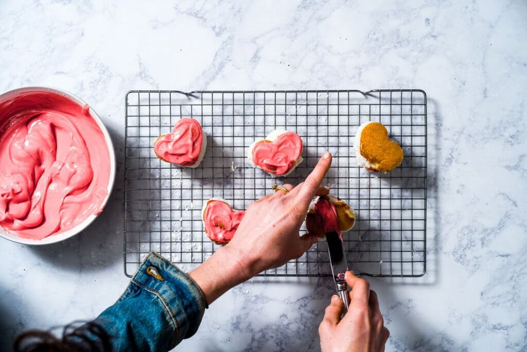 For a healthier twist on the classic Little Debbie Valentine's Day cakes, these Mini Strawberry Heart Cakes with a Greek yogurt frosting are an adorable and delicious way to celebrate the day.