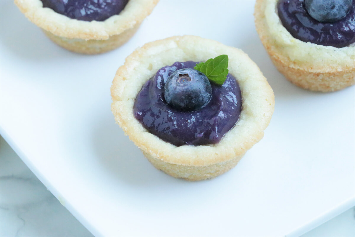 Wild Blueberry-Lemon Curd Cookie Tarts from Holley Grainger