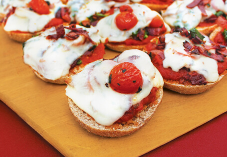 BLT Mini Pizza Bagel - Get back into your routine with these deliciously simple, affordable back-to-school recipes that work double duty to make mealtime and snacks easy and fast.