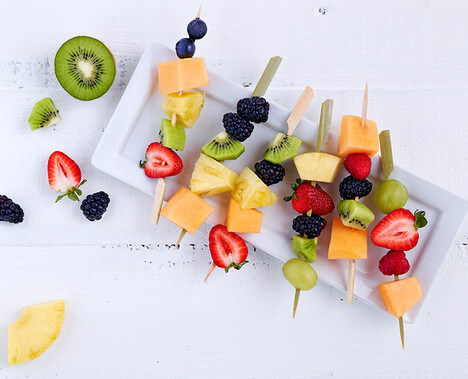 Fruit Salad Kebabs - Get back into your routine with these deliciously simple, affordable back-to-school recipes that work double duty to make mealtime and snacks easy and fast.