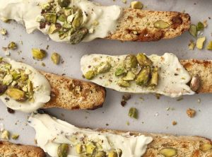 Pistachio, White Chocolate and Cardamom Biscotti from Holley Grainger - a holiday potluck food that travels well